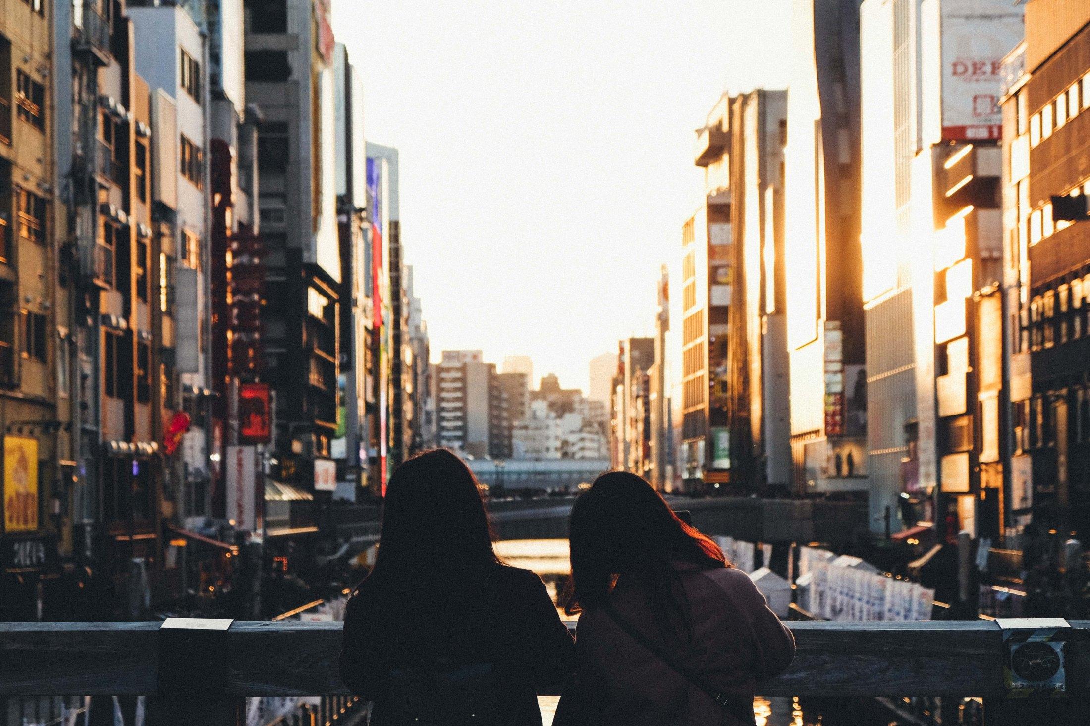 Street photowalk. Sunset in Dotonbori.